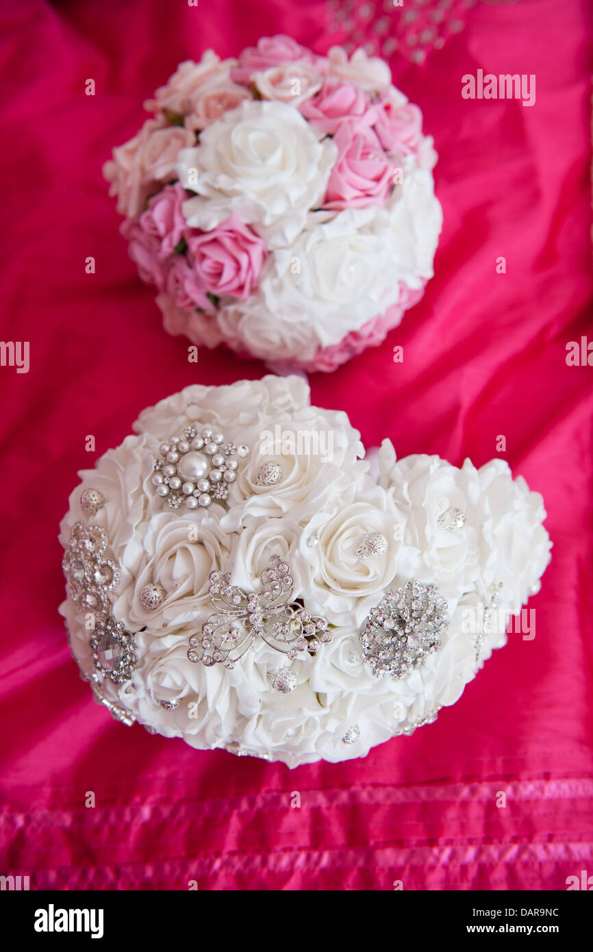 Brooch bouquet stock photos brooch bouquet stock images alamy white fabric bridal bouquet with butterfly and flower diamant brooches and pastel pink and white wedding izmirmasajfo