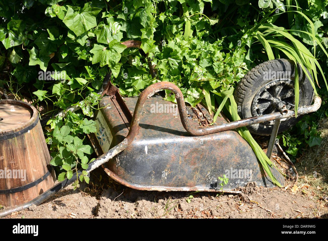 Disused wheelbarrow - Stock Image