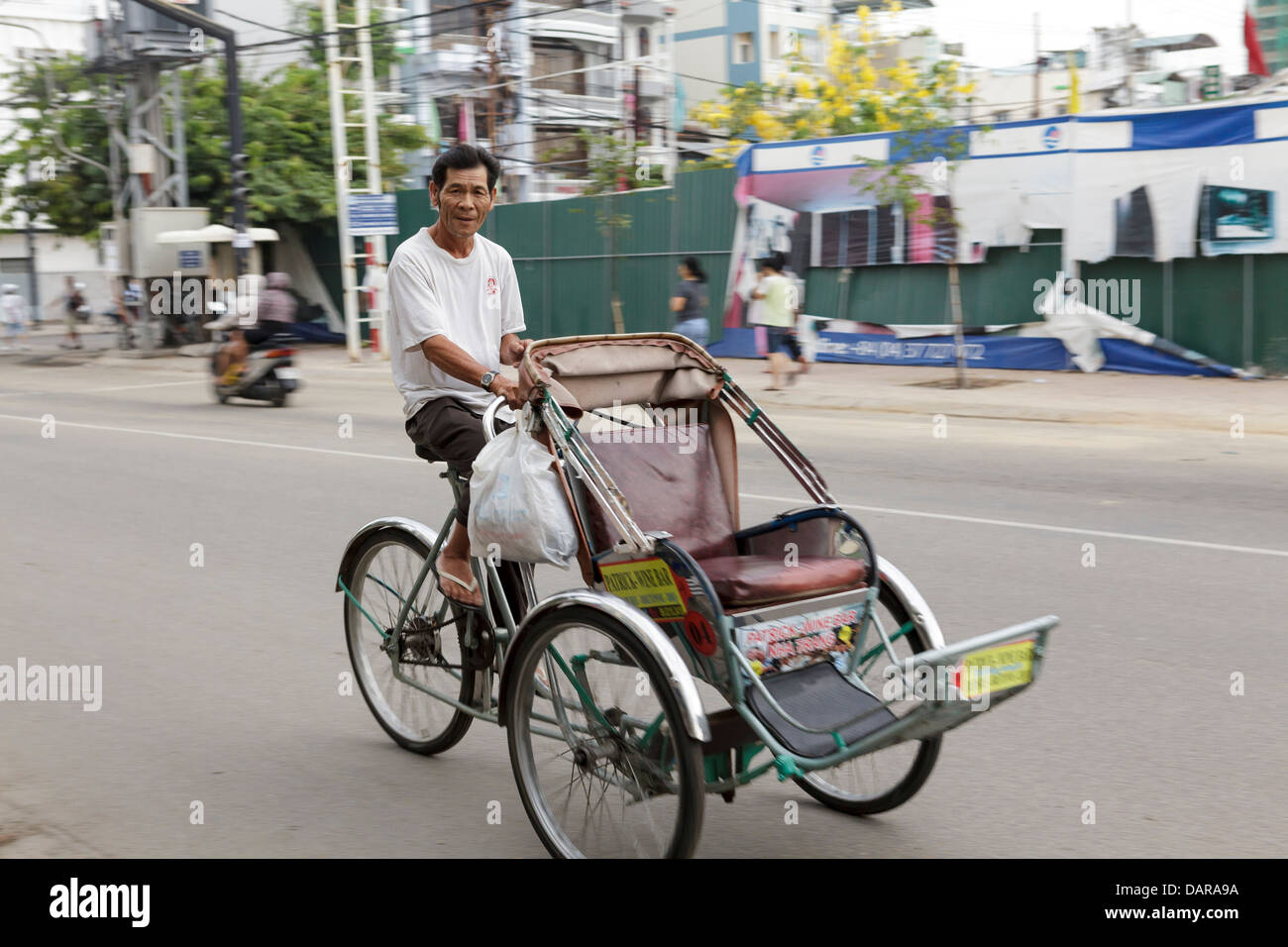 A man riding a tricycle taxi, Nha Trang, Vietnam, South East Asia. Stock Photo