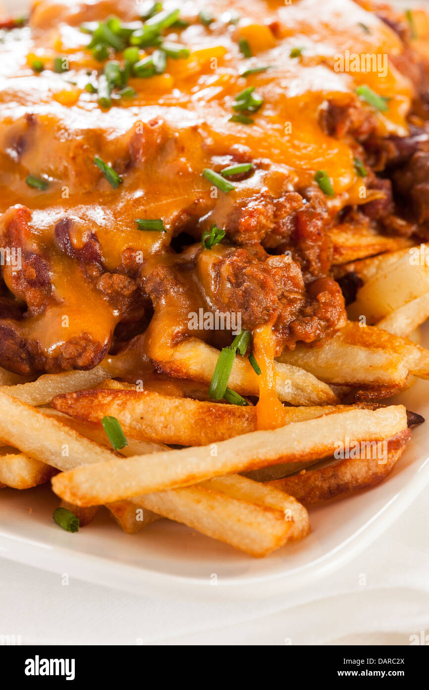 Unhealthy Messy Chili Cheese Fries on a Background - Stock Image