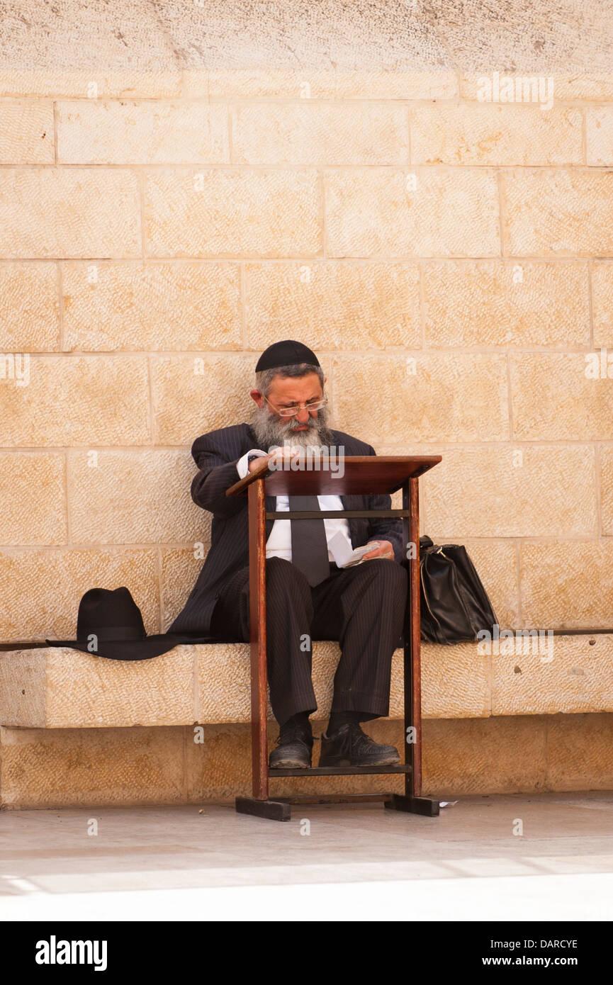 Israel Jerusalem Old City Wailing Western Wall Ha Kotel Plaza orthodox Jew Jewish man grey gray beard prays praying - Stock Image