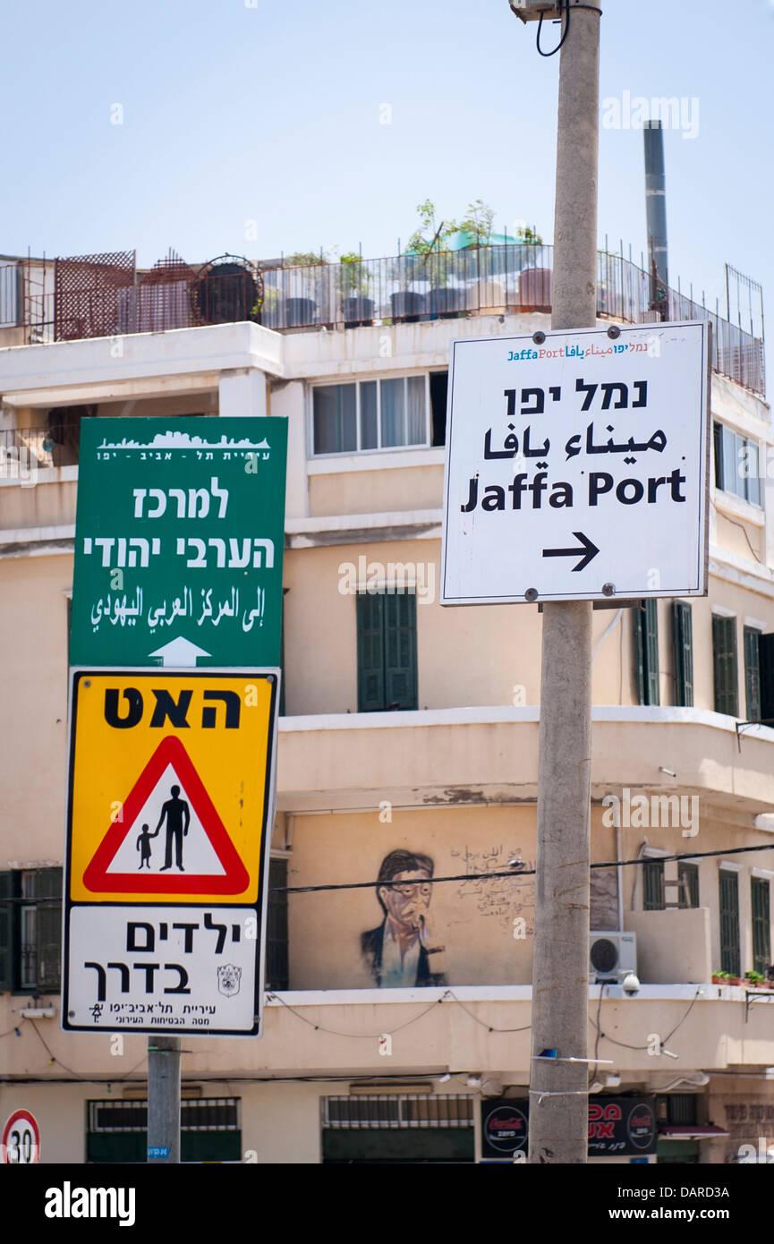 Israel Jaffa Yafo Joppa Yefet street scene road signs graffiti flats apartments condos balconies roof terrace air - Stock Image