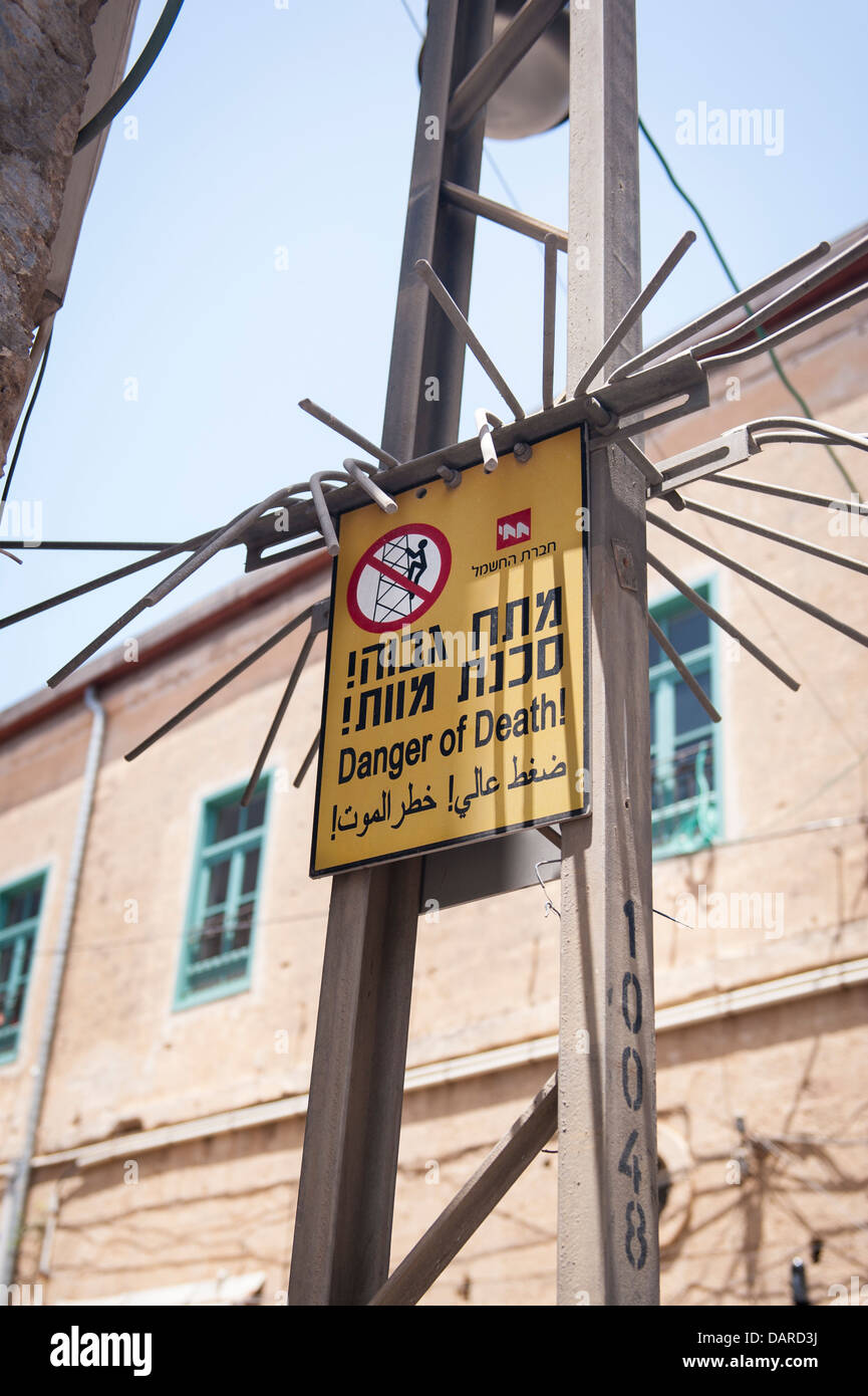 Israel Jaffa Yafo Old City port electric electricity cable gantry anti climb barrier device detail sign Danger of - Stock Image
