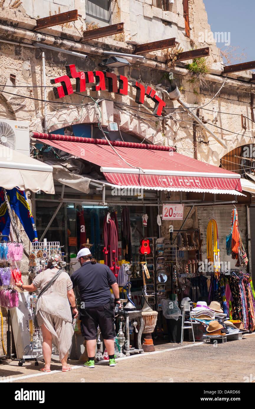 Israel Tel Aviv Jaffa Yafo novelty souvenir tourist memorabilia shop hats flip flops kaftans 2 two large fat obese - Stock Image