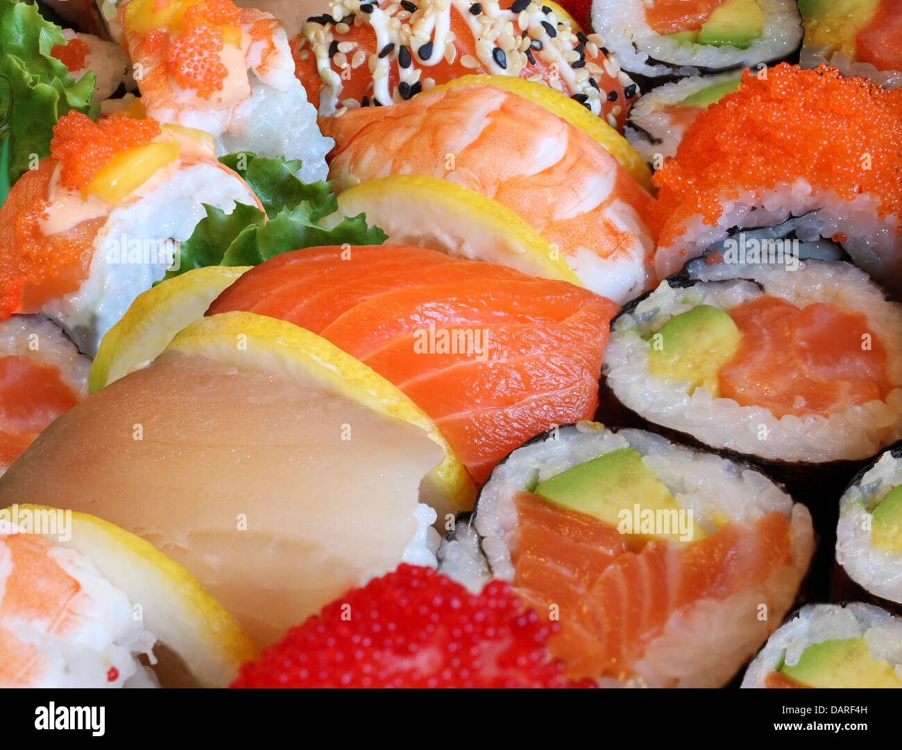 Japanese sushi close up with a variety of delicious prepared fresh raw fish and seafood as salmon shrimp and caviar - Stock Image