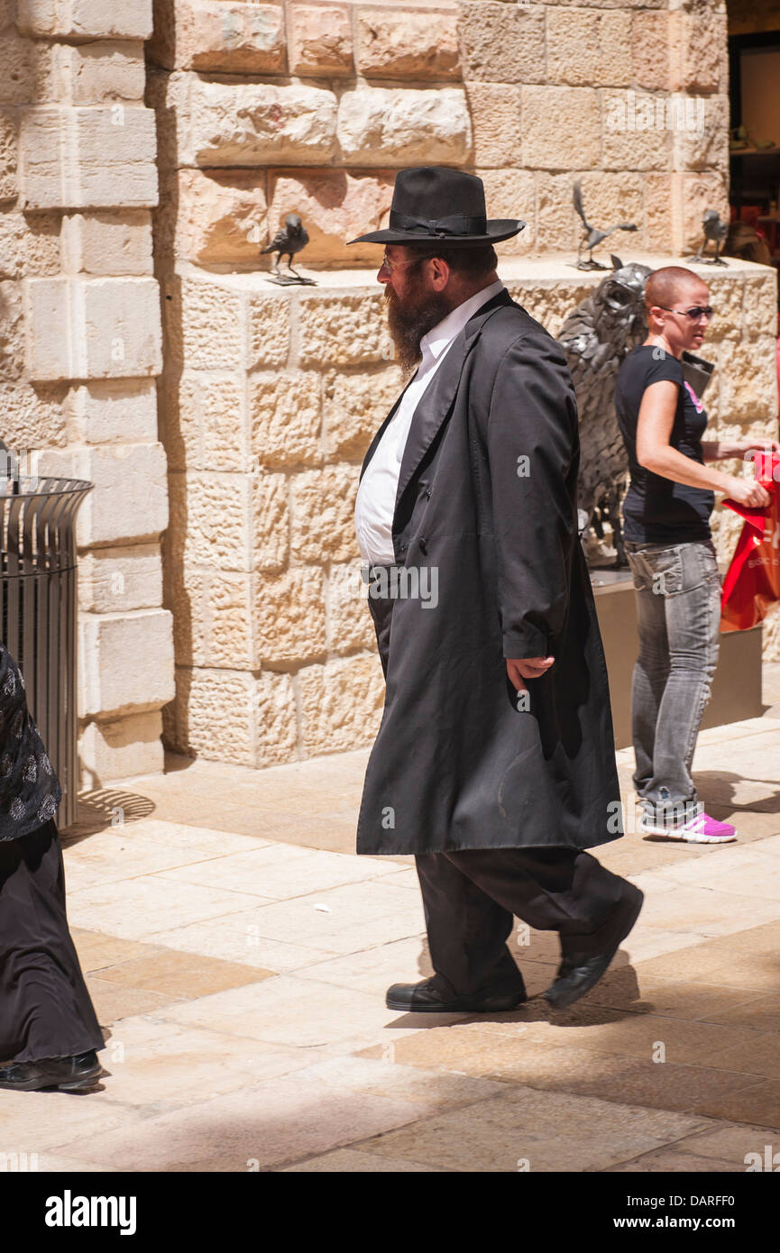 4d500e1e1a8 Israel Jerusalem Ultra Orthodox Jewish Hassidic bearded man walking in  modern contemporary stylish Alrov Mamilla Avenue Mall