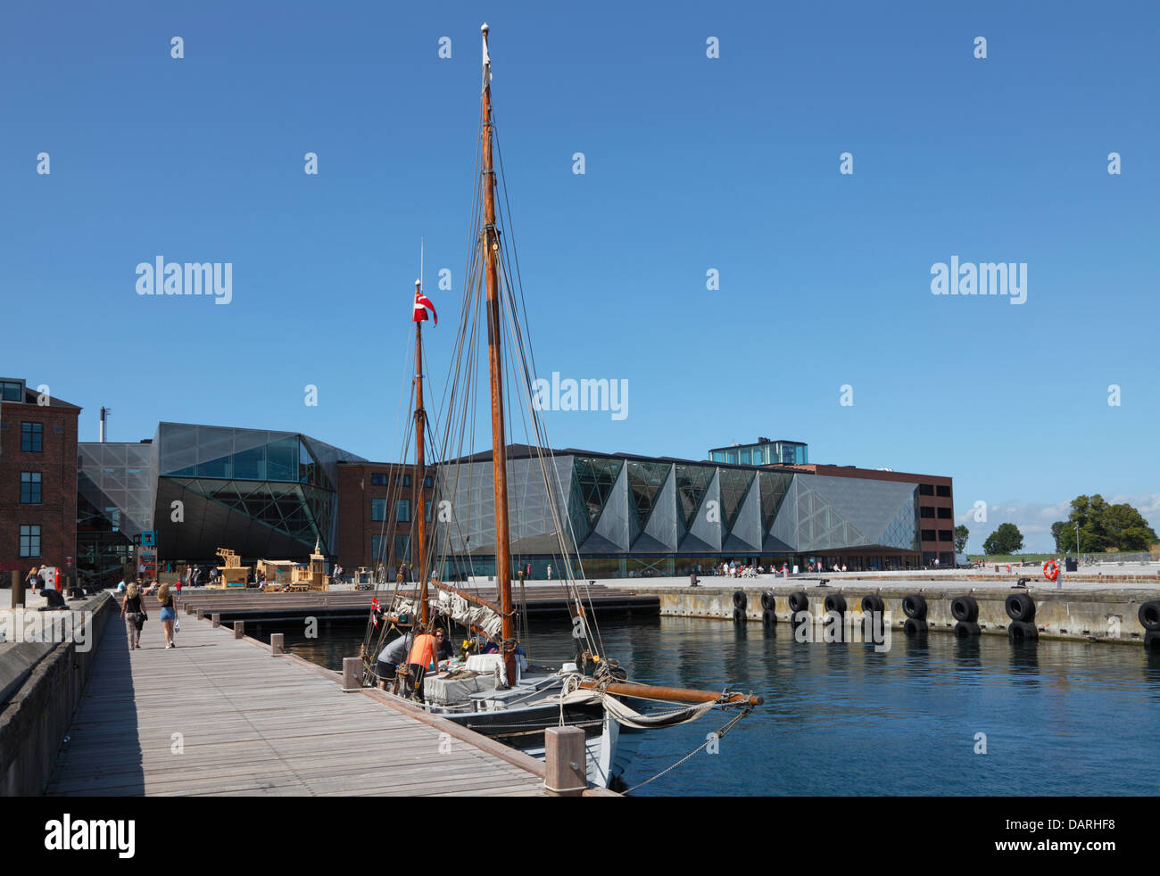 Old sailing ship in front of The Culture Yard on the waterfront in the harbour of Elsinore, Helsingør, Denmark. - Stock Image