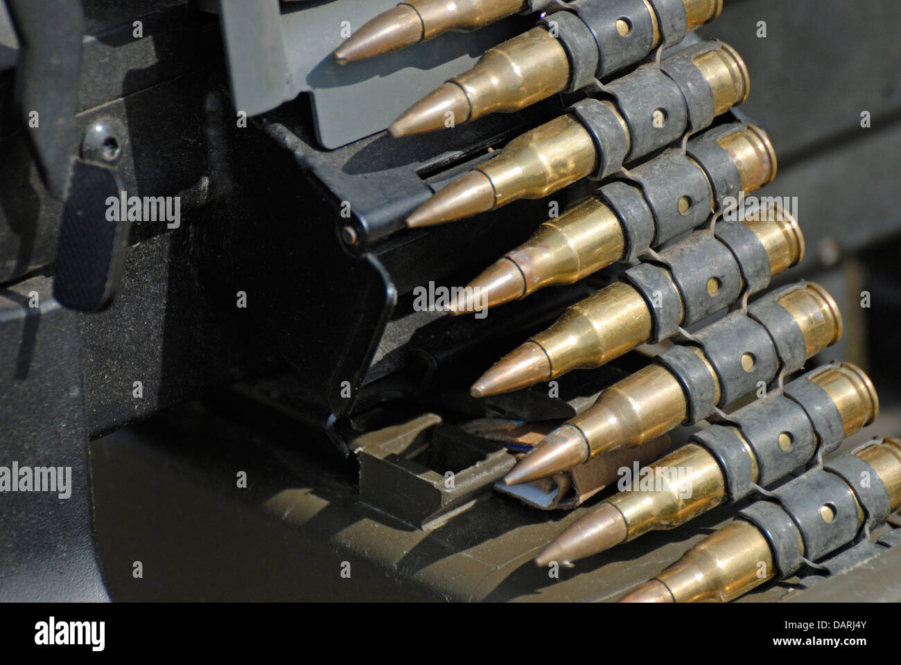Machine gun bullets in belt fed through gun. War and Peace Revival, July 2013, Folkestone Racecourse, Kent, England, - Stock Image