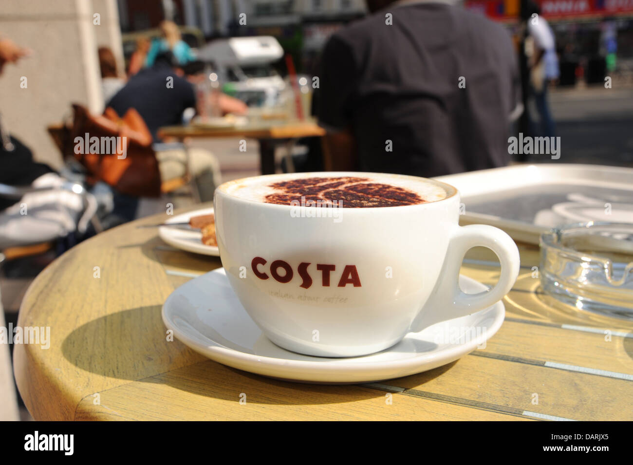 Cappuccino Coffee Cup On Table Outside Costa Coffee Cafe Brighton UK - Costa coffee table