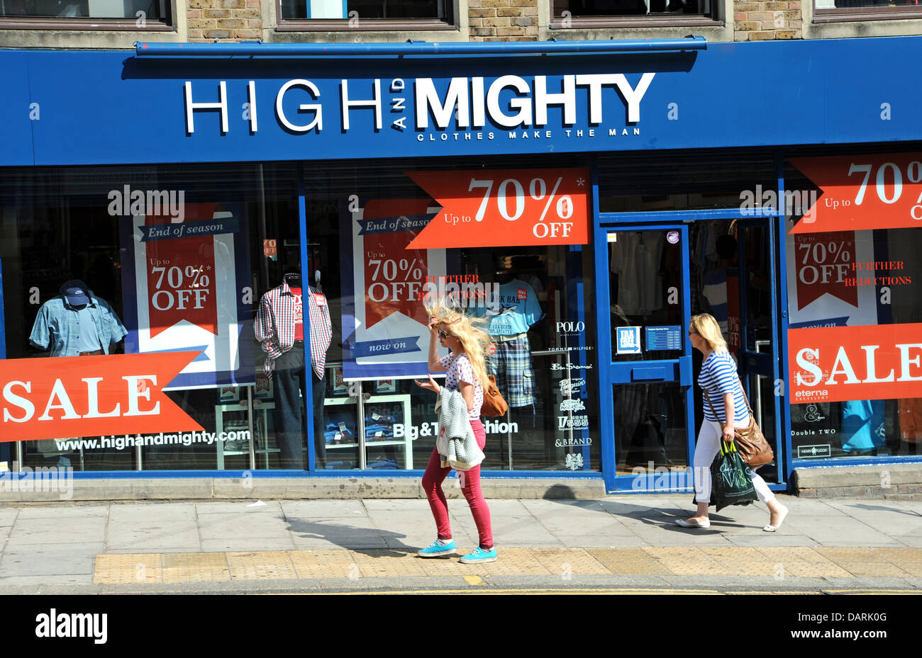 High and Mighty speciality Clothing shop for larger people with sale offer signs on window Brighton UK - Stock Image