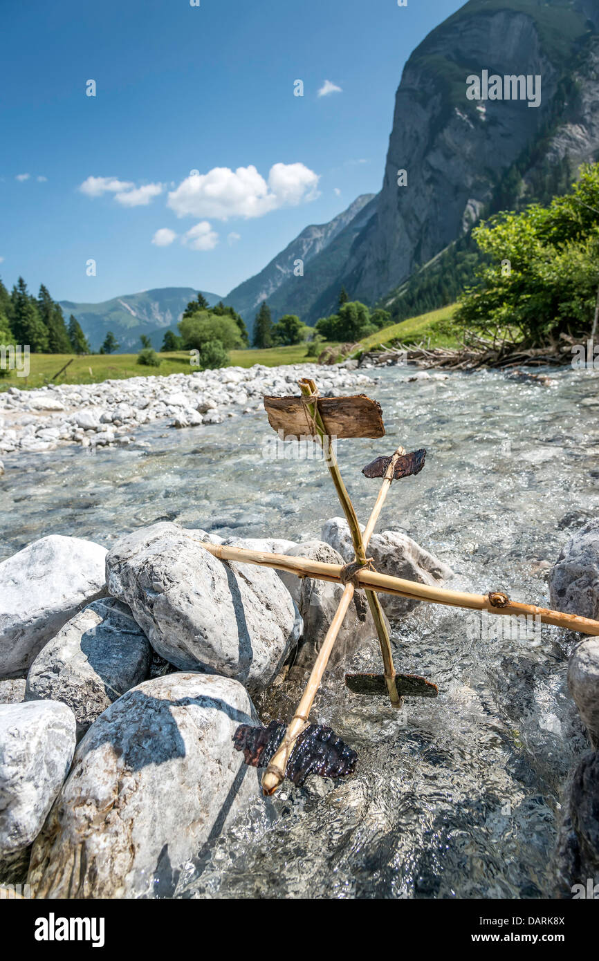 Simple water wheel in a river in the Alps - Stock Image