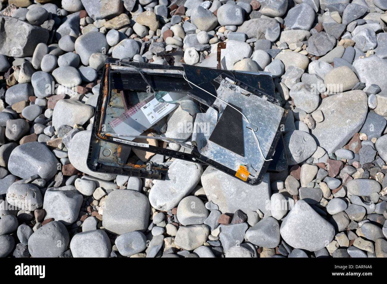 Smashed Up Portable Computer or Laptop on beach - Stock Image