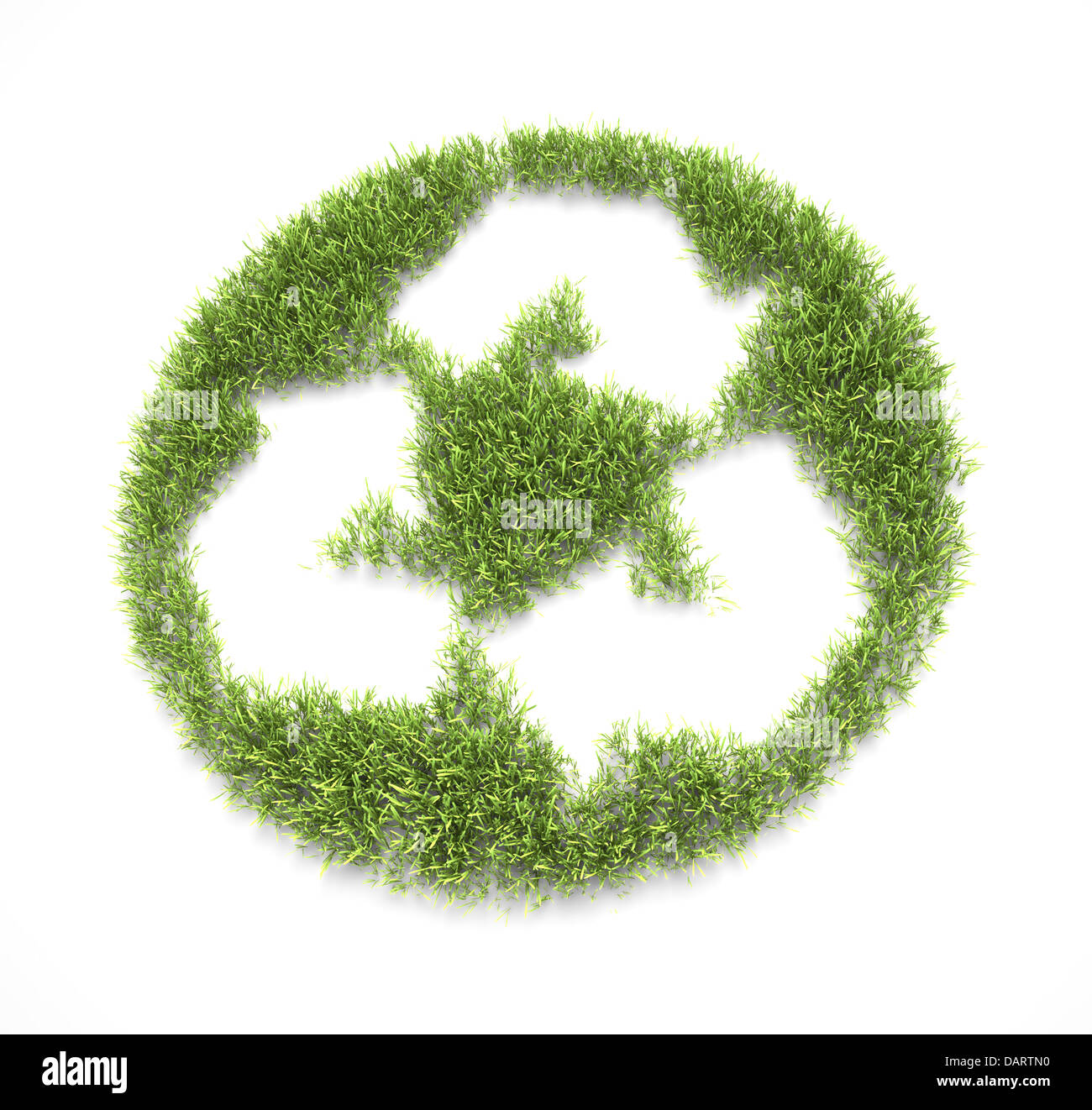 Grass patch shaped like a recycling symbol - Stock Image