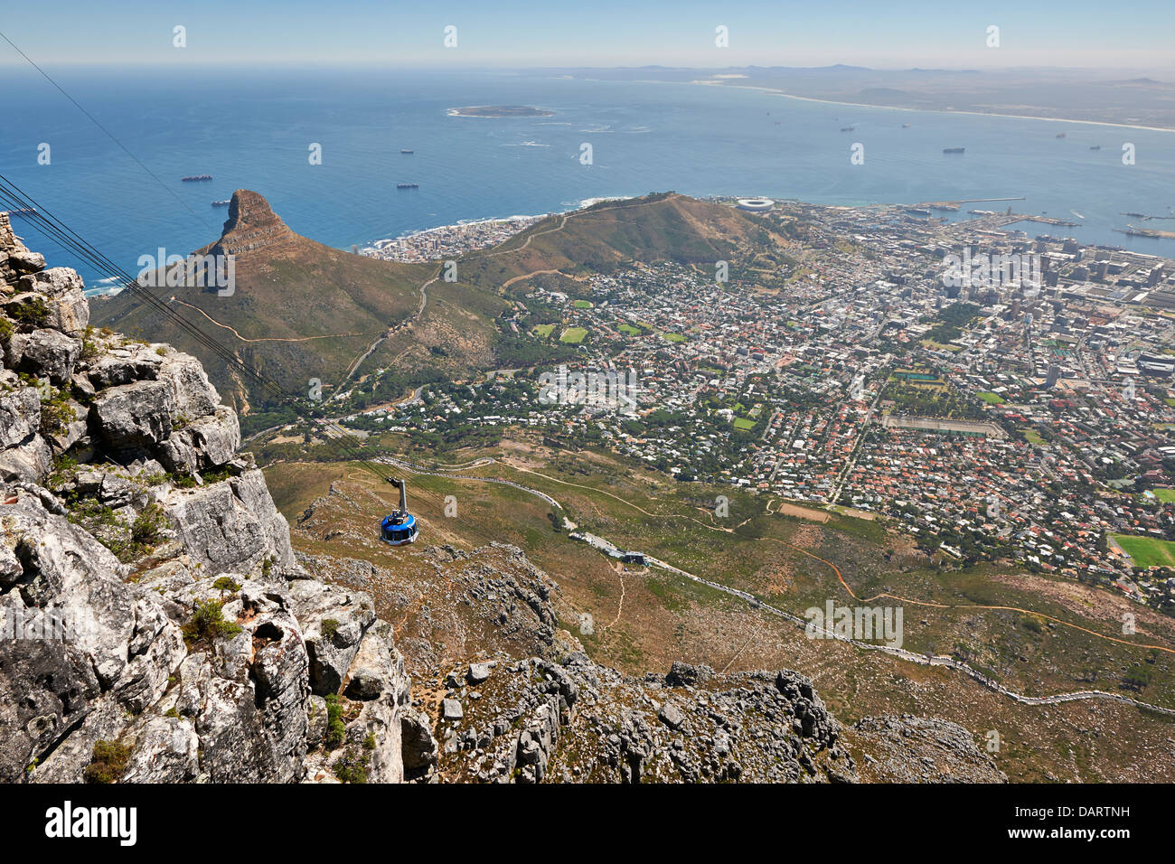 view from Table Mountain onto Cape Town with lion head and cable car, Western Cape, South Africa - Stock Image