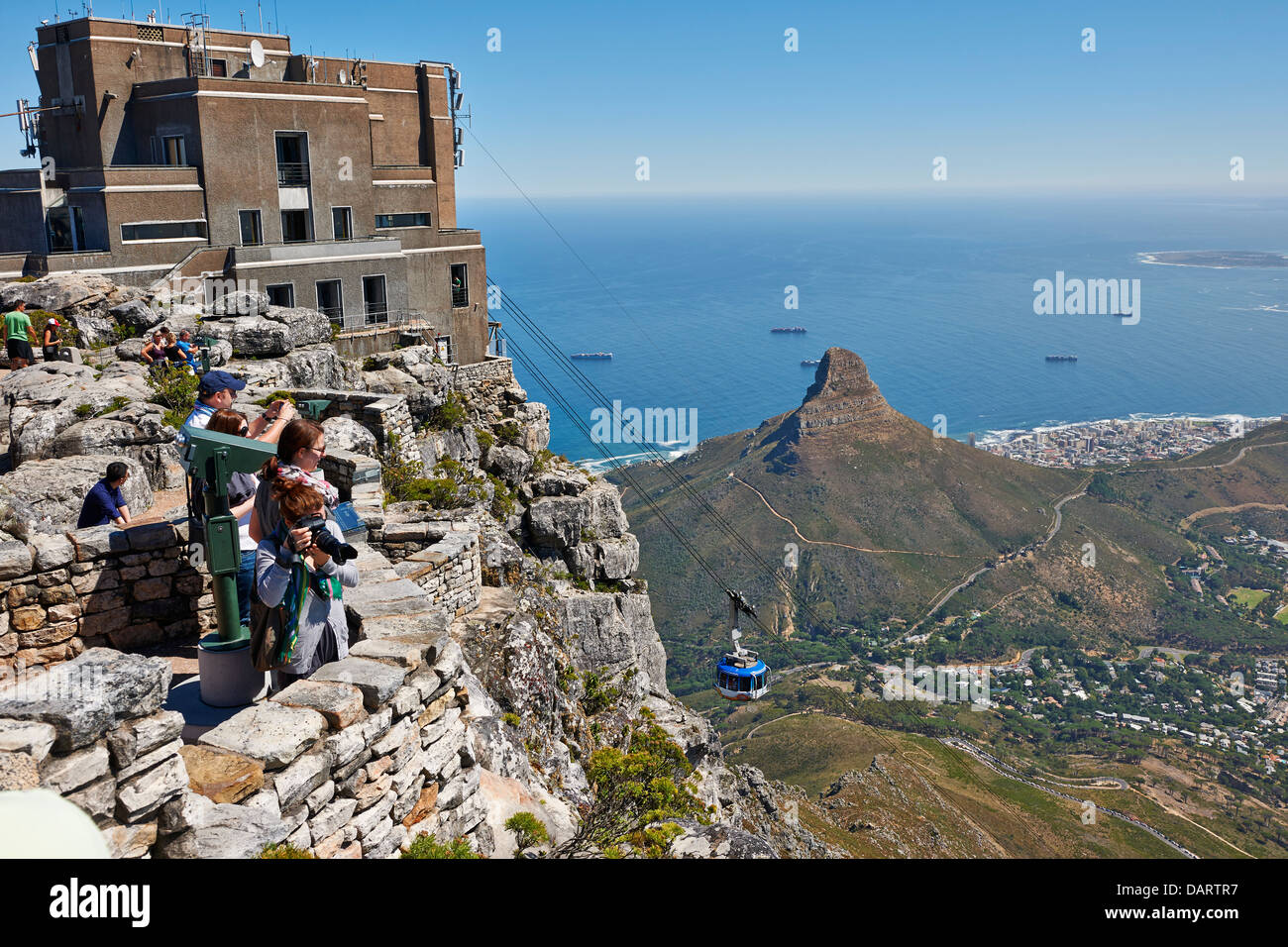 view from Table Mountain onto Cape Town with lion head and cable car with upper station, Western Cape, South Africa - Stock Image