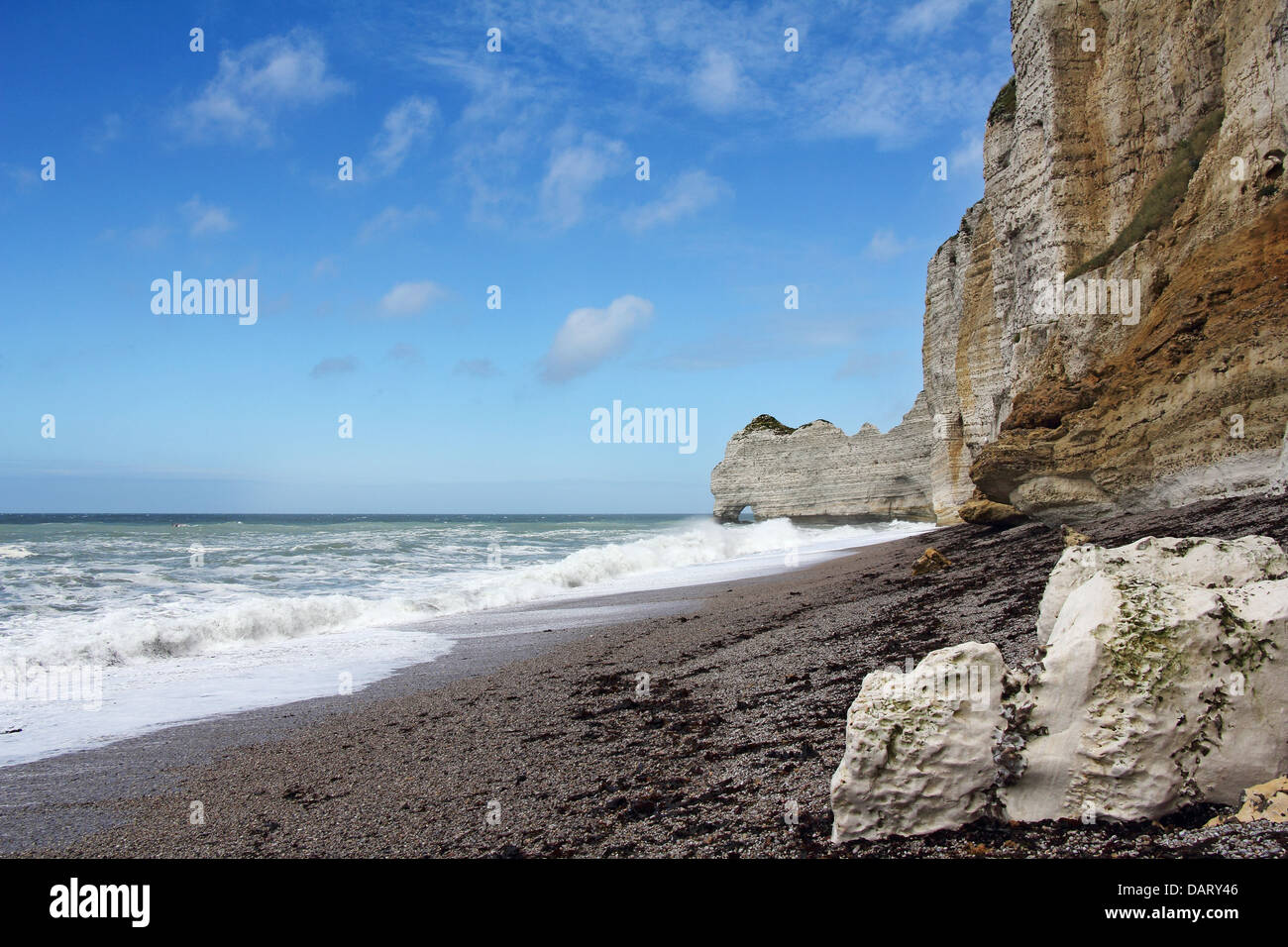 Etretat, natural rock arch wonder, cliff and beach. Normandy, France. - Stock Image