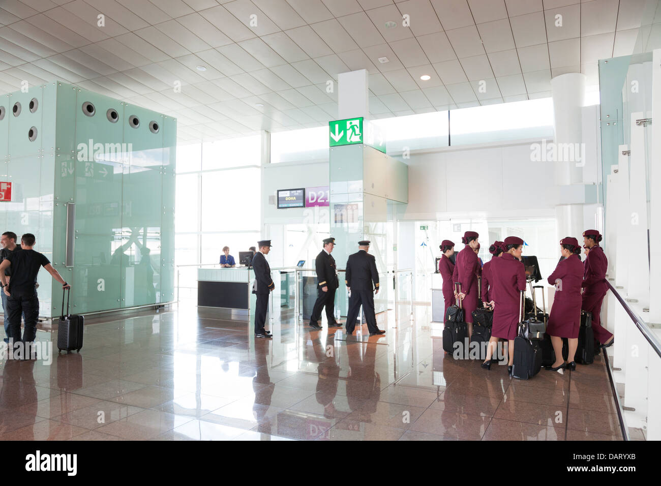 Qatar airways pilots and cabin staff waiting at departure gate - Stock Image