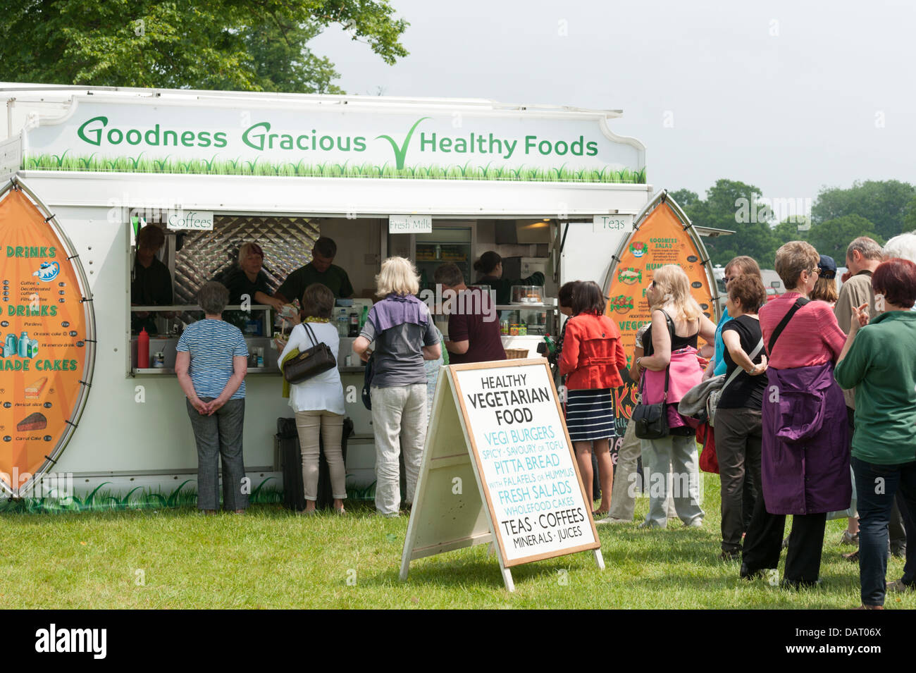 Customers queuing at the Goodness Gracious Healthy Foods stall at Blenheim Palace Flower Show UK - Stock Image