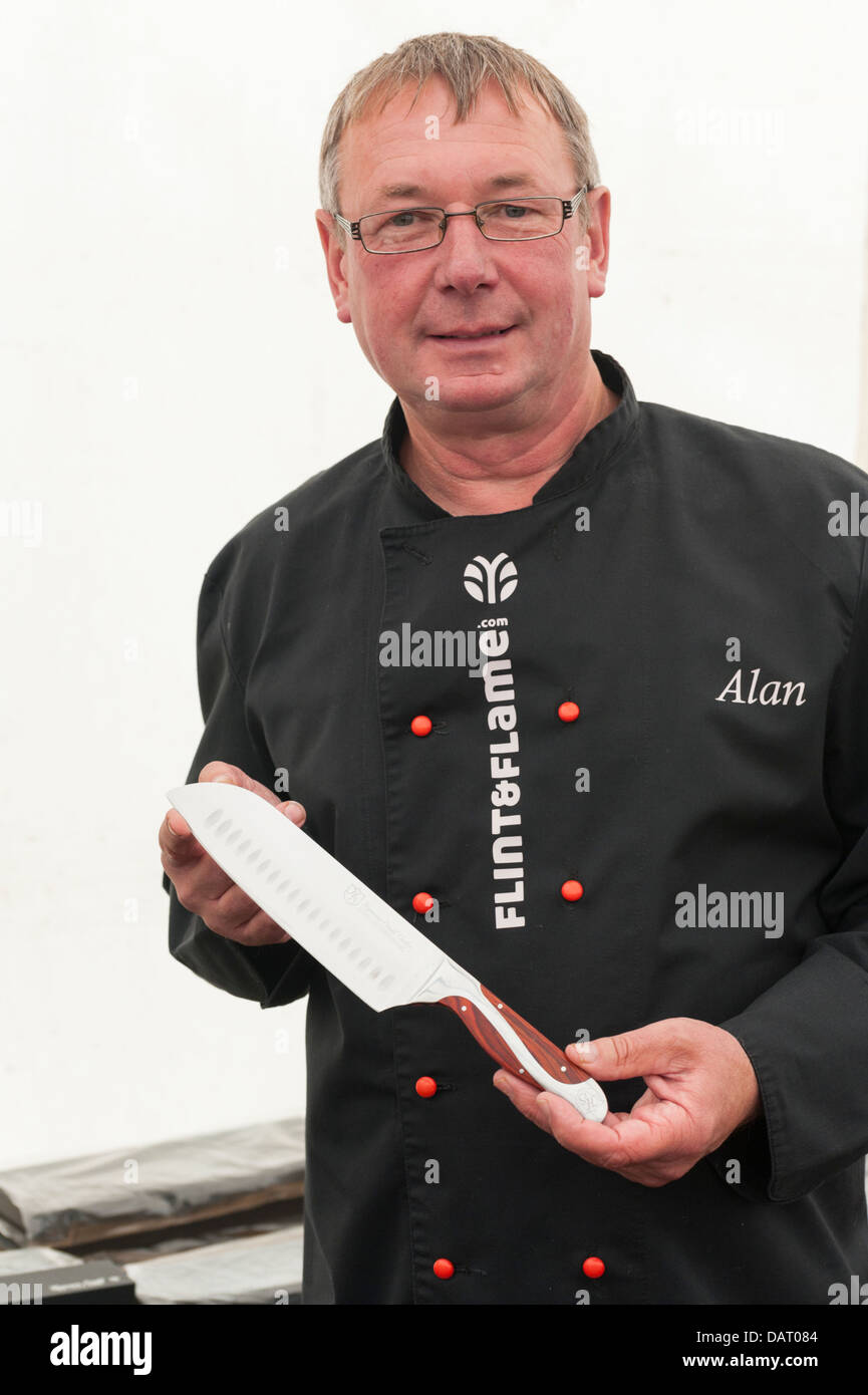 A man holding a knife at the Flint and Flame stall at Blenheim Palace Flower Show UK - Stock Image