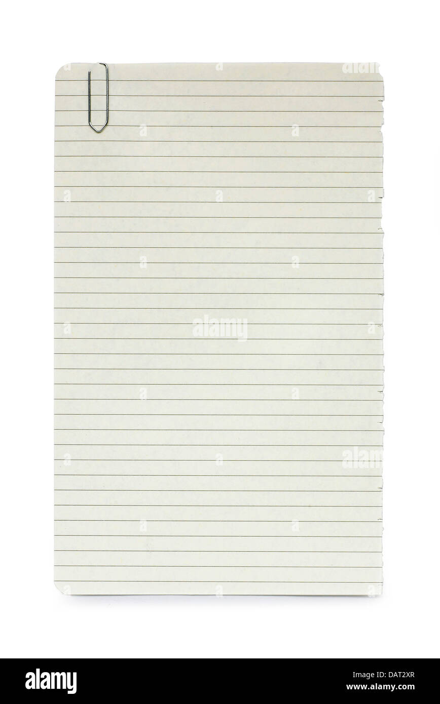sheet of lined blank notepaper with paperclip cut out onto a white background - Stock Image