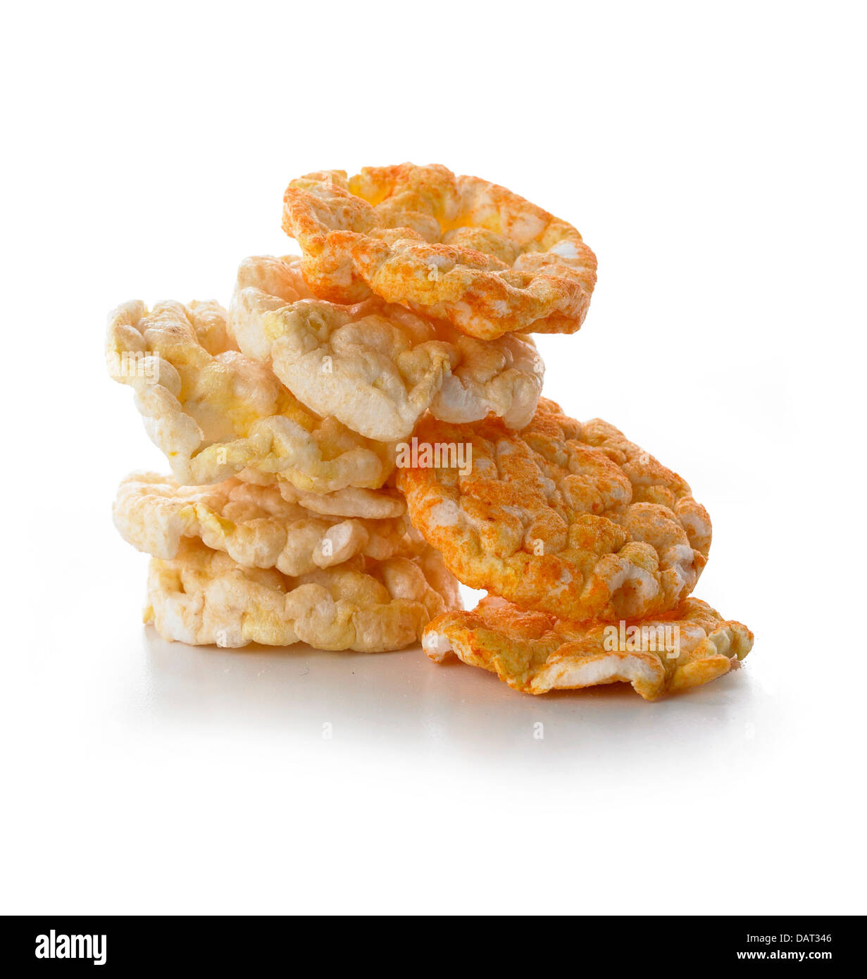 pile of rice crackers cut out onto a white background - Stock Image