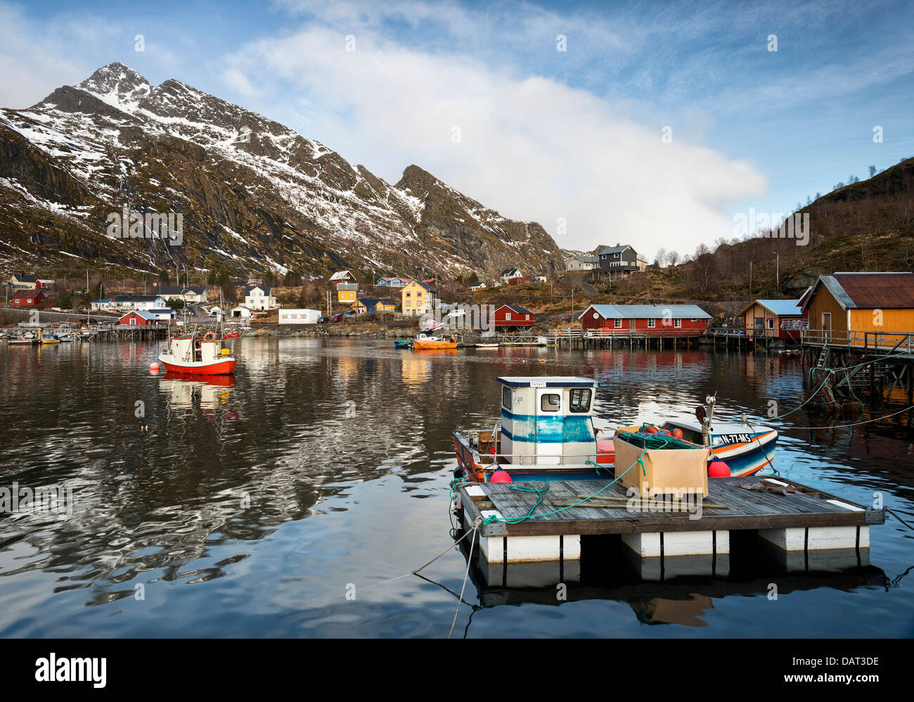 The pretty harbour at Mosknes on the Lofoten Islands, Norway with Merraflestinden in the background - Stock Image