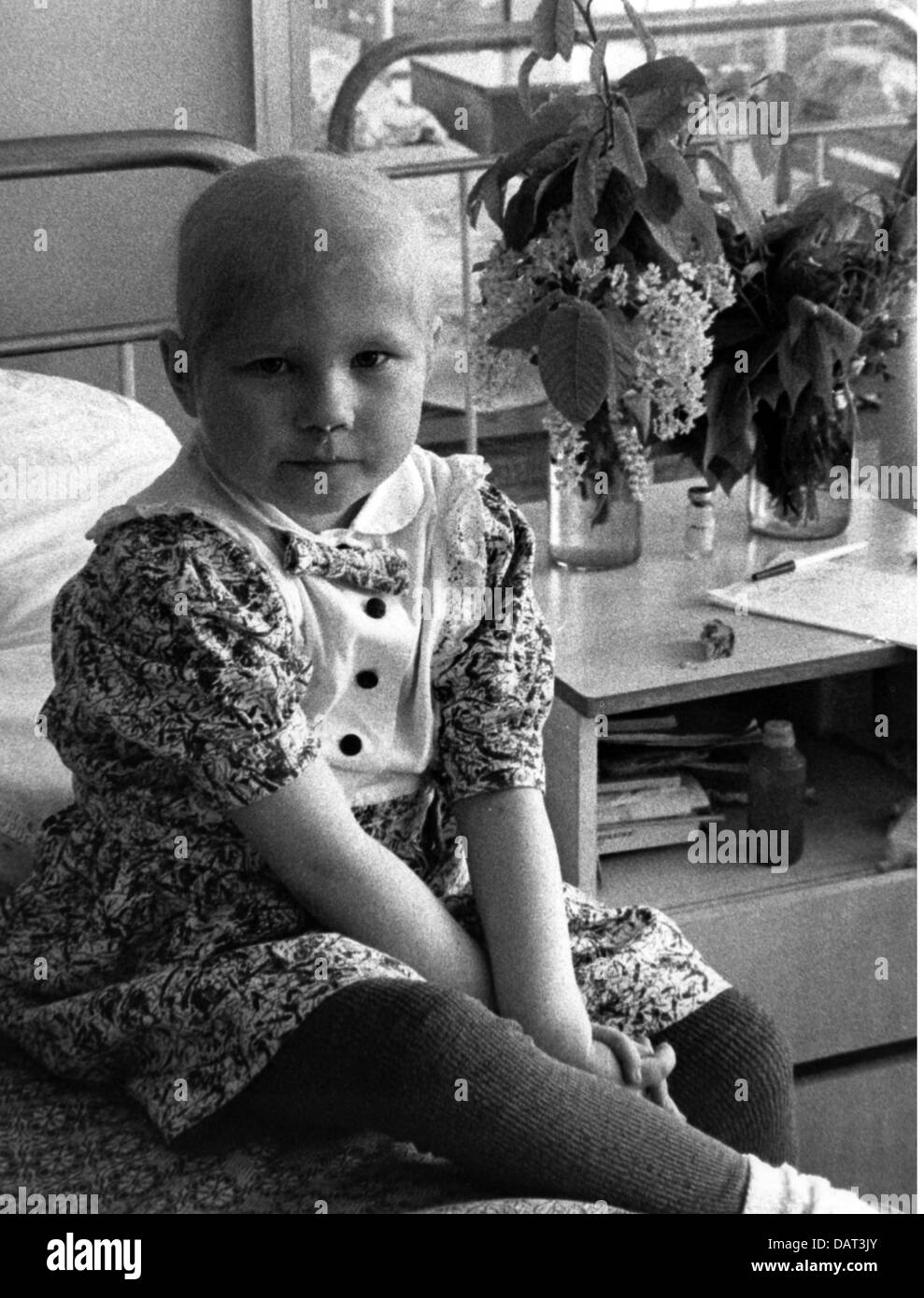 medicine, sick people, little girl, contaminated by radiation after the Chernobyl disaster, in a children's - Stock Image