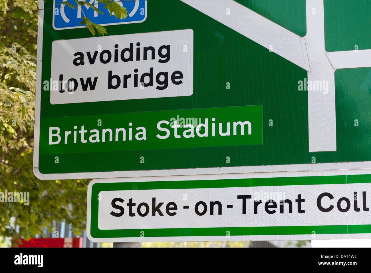 Sign in Stoke on Trent saying Britannia Stadium ( home of Stoke City FC ) avoiding low bridge ,Stoke on Trent College - Stock Image