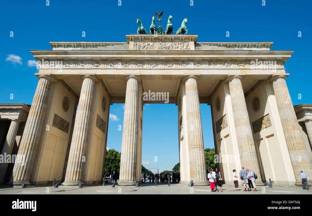People in front of Brandenburg Gate in Berlin Germany - Stock Image
