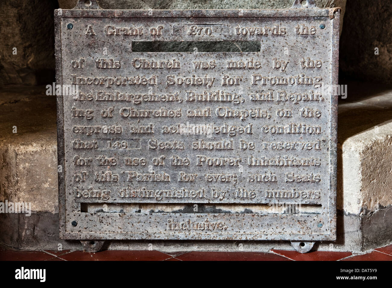 St Stephen's Church, Old Radnor, Powys, UK. An old  plaque recording a charitable donation to the church - Stock Image