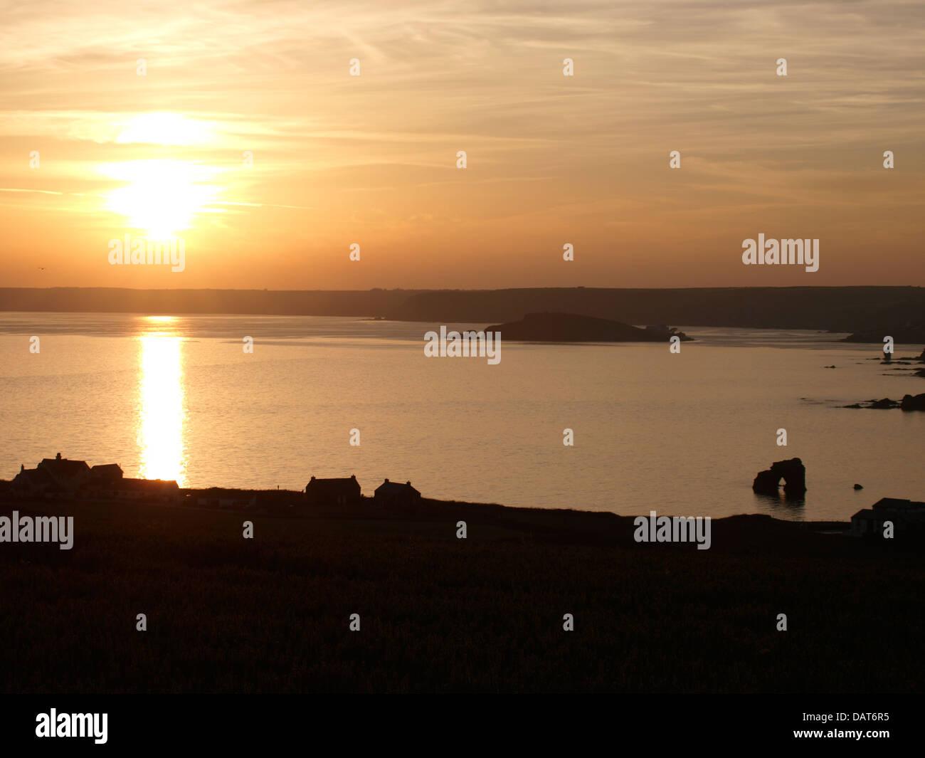 Sunsetting at Thurlestone Rock, Devon, UK - Stock Image
