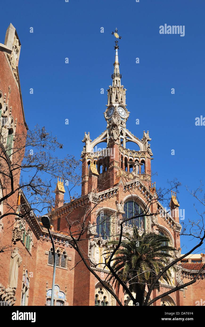 Hospital of Saint Paul ( Hospital de Sant Pau). Built 1930. Barcelona. Catalonia. Spain. Clocktower and spire. - Stock Image