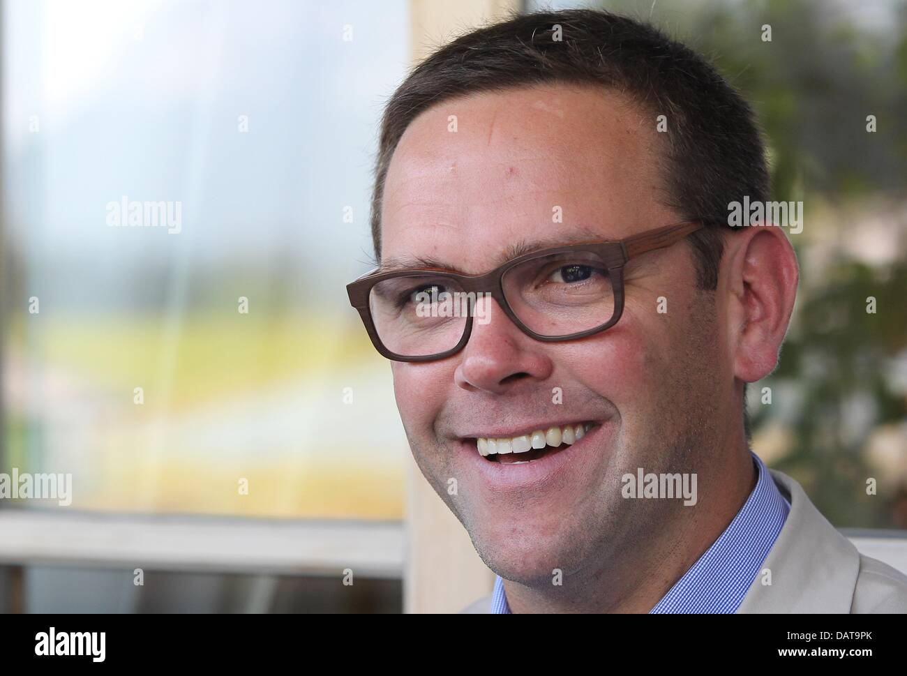 Going, Austria. 17th July, 2013. British media entrepreneur James Murdoch smiles at 'Camp Beckenbauer' in - Stock Image