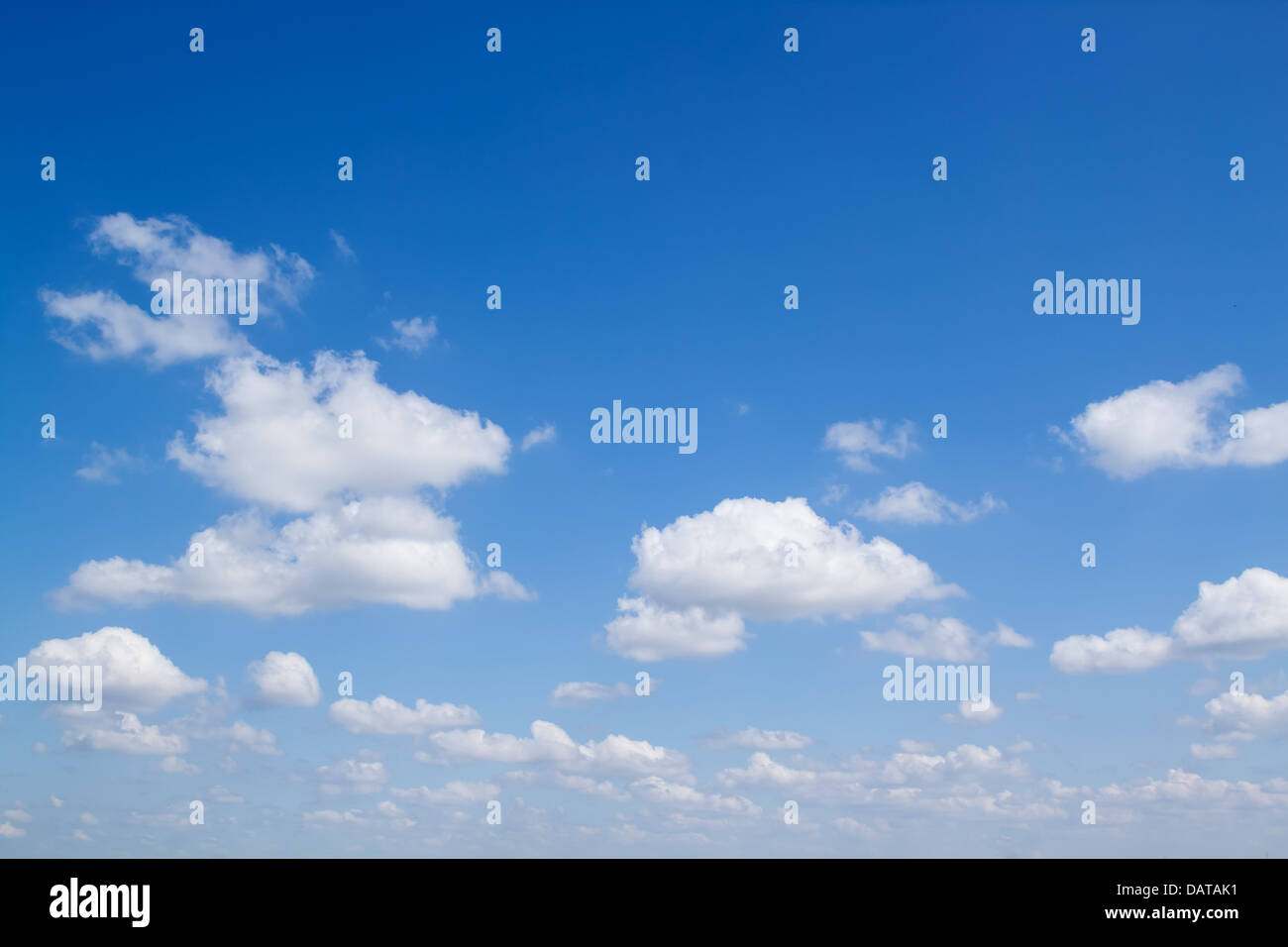 White fluffy clouds in the blue sky Stock Photo
