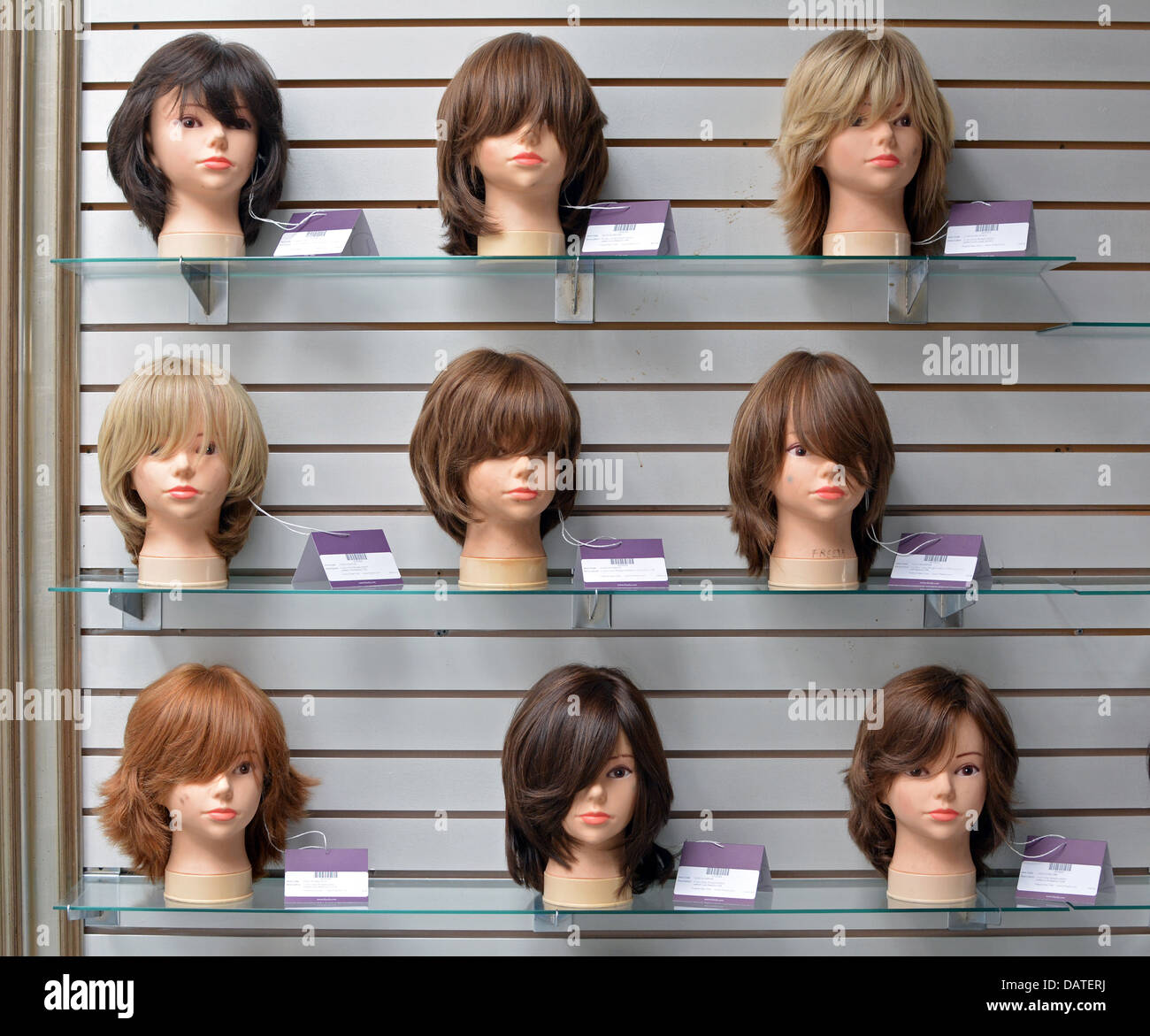Wigs on mannequins at  a factory in Crown Heights, Brooklyn, NY, frequented by religious Jewish women buying sheitels - Stock Image