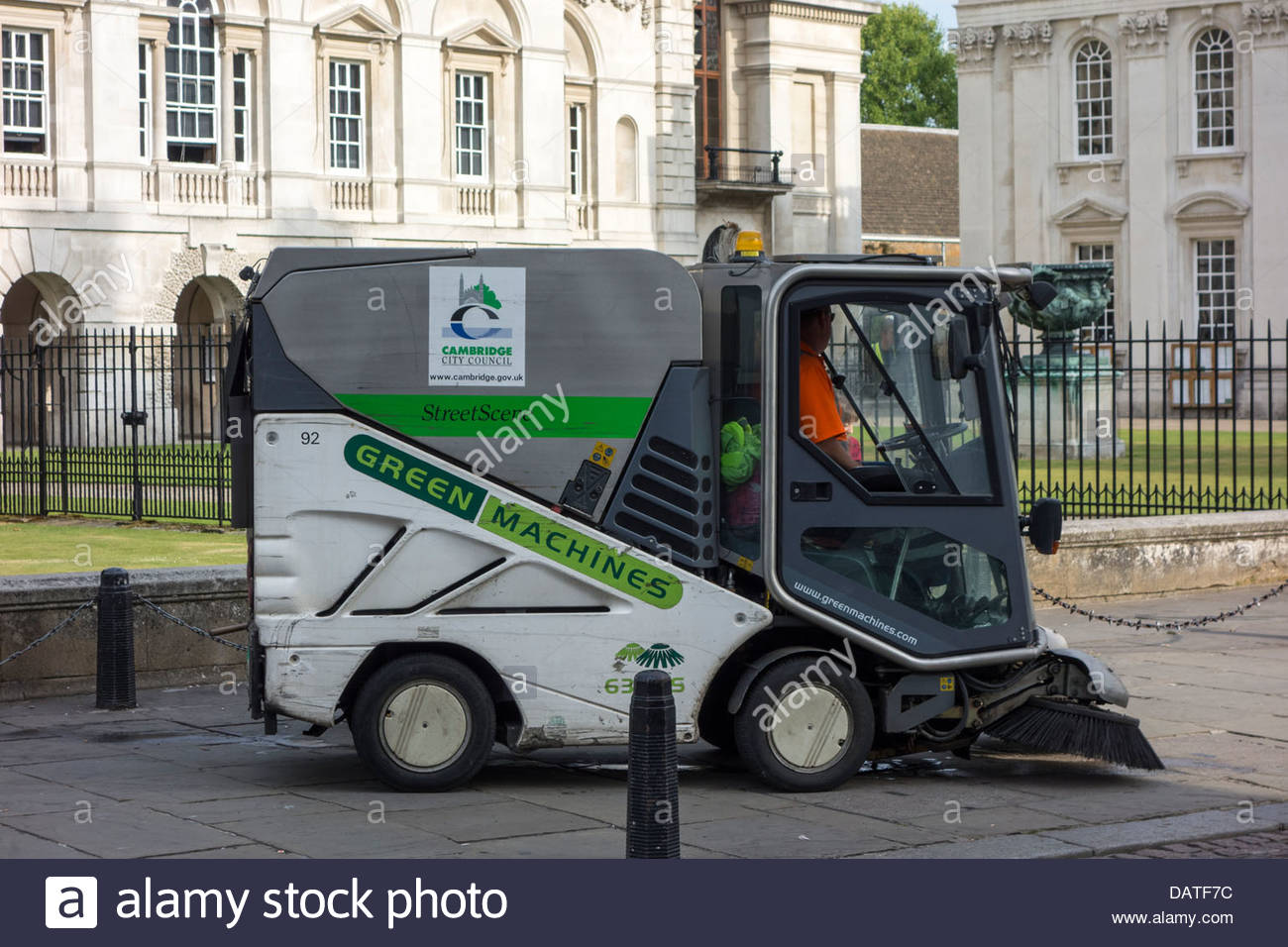 Cambridge City Council street cleaning machine on Kings Parade in Cambridge in the early morning Stock Photo