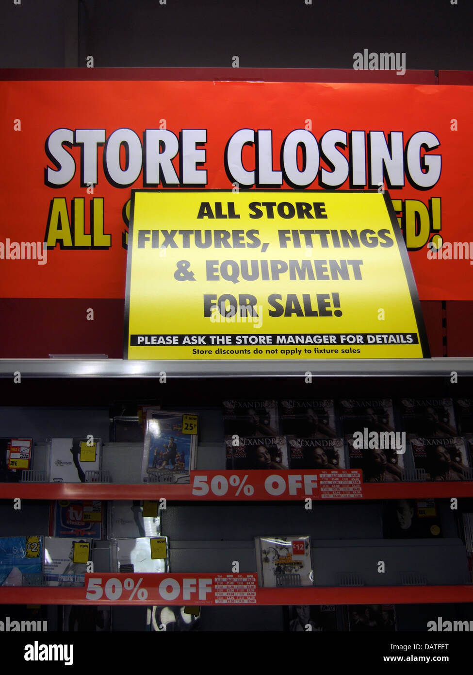 Store closing down signs, during recession. - Stock Image