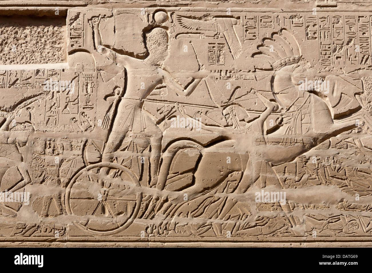 Pharaoh driving chariot scene at The Temple of Amun at Karnak, Luxor Egypt - Stock Image