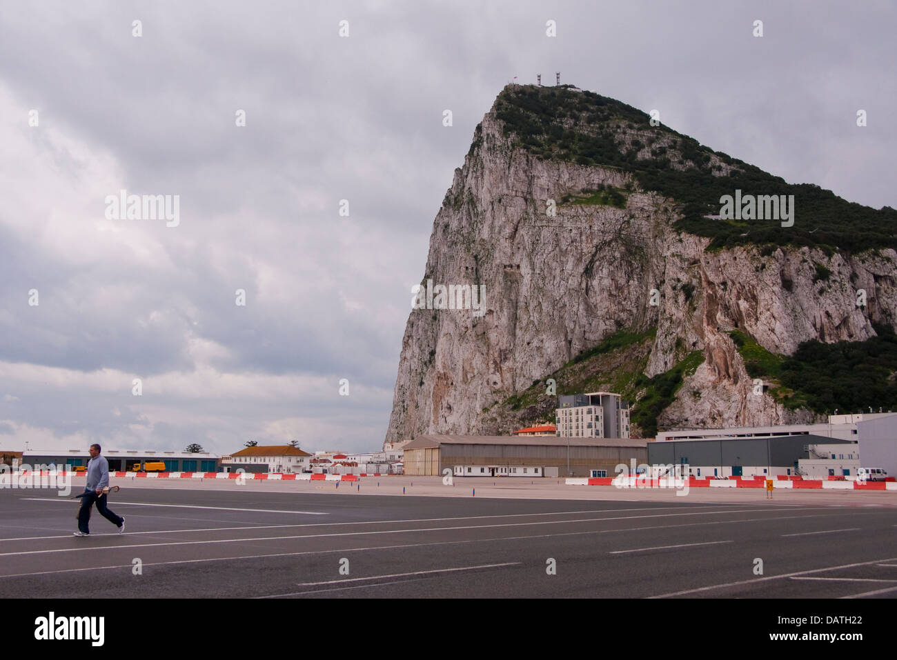 Pedestrian crossing the airport runway in Gibraltar. - Stock Image