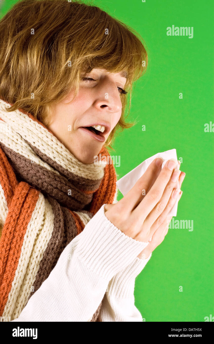 cold girl sneezes - Stock Image