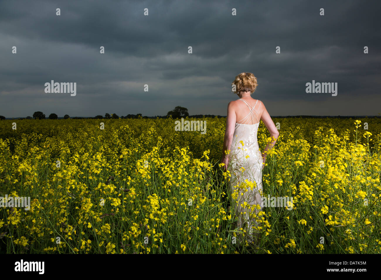 woman standing in field in open countryside - Stock Image