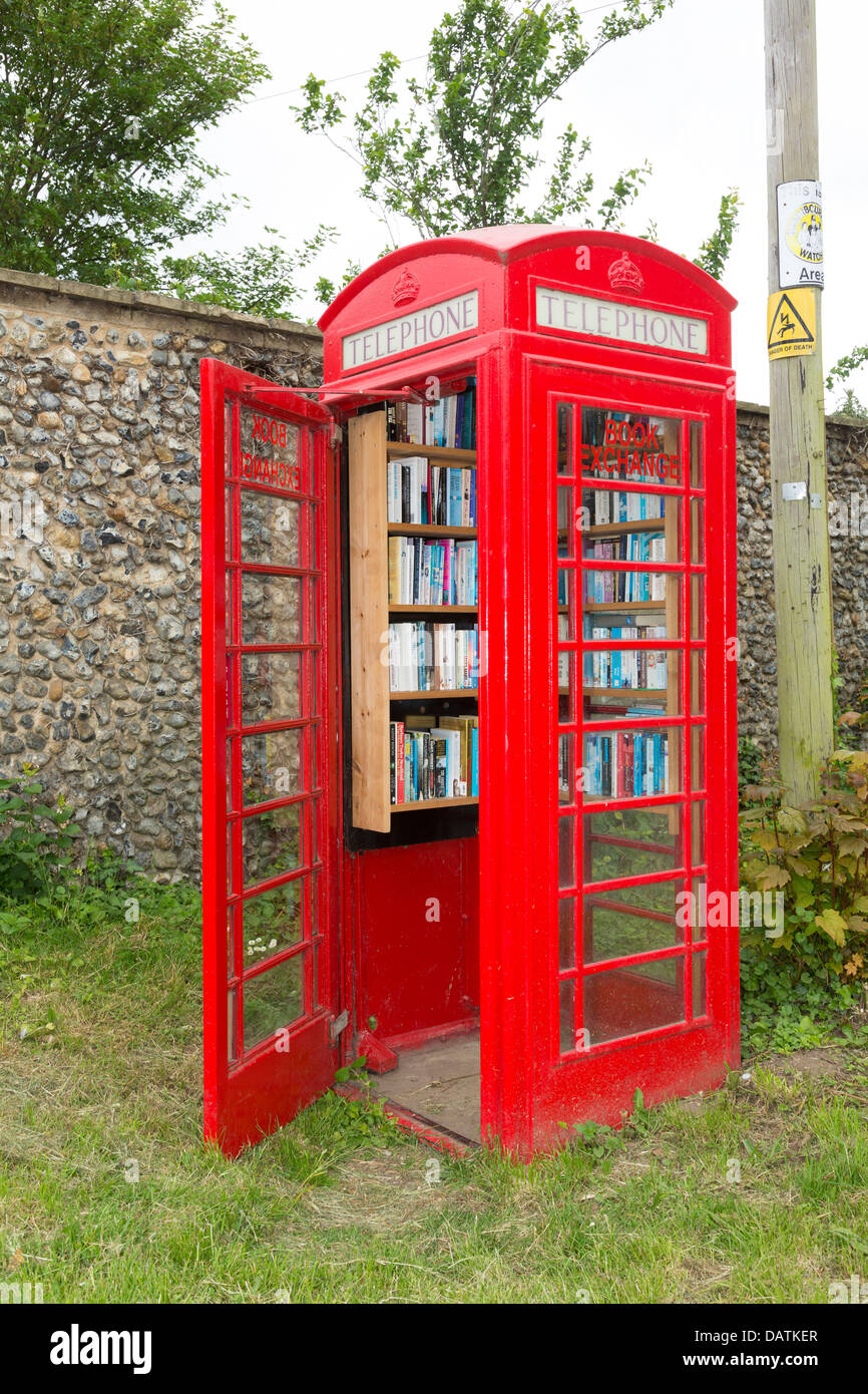 village local library installed in disused red telephone box - Stock Image