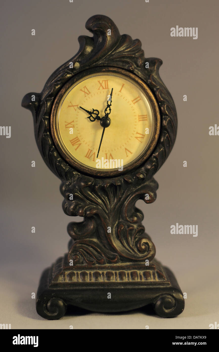 Antique looking clock with Roman Numerals - Stock Image