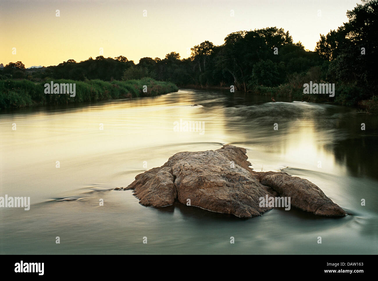 Dusk photograph of moving water of the Olifants River, South Africa - Stock Image
