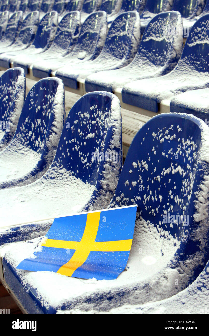 A Swedish flag lies on the snow-covered seats before the Men's Downhill of the Alpine Skiing World Championships - Stock Image