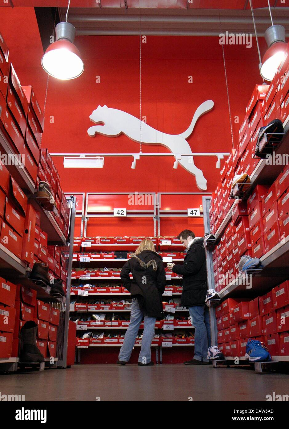 Two customer look for shoes at a PUMA outlet store in Bremen