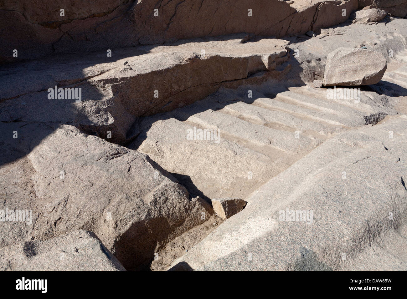 Quarry workings in The Unfinished Obelisk Open Air Museum, Northern Quarries, Aswan, Egypt - Stock Image