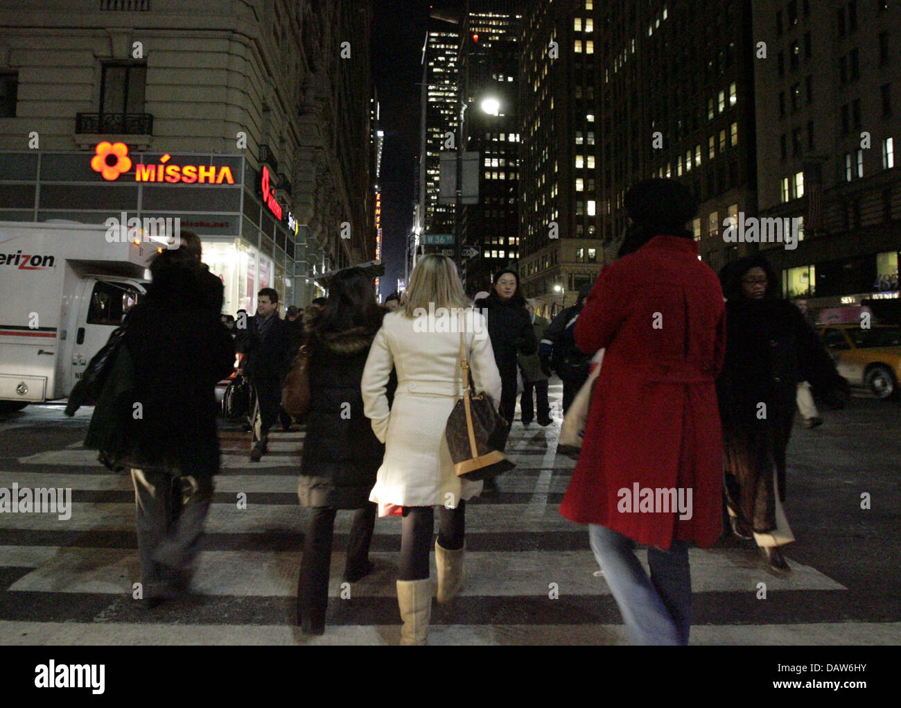 pedestrians walk over a crosswalk at night in new york. Black Bedroom Furniture Sets. Home Design Ideas