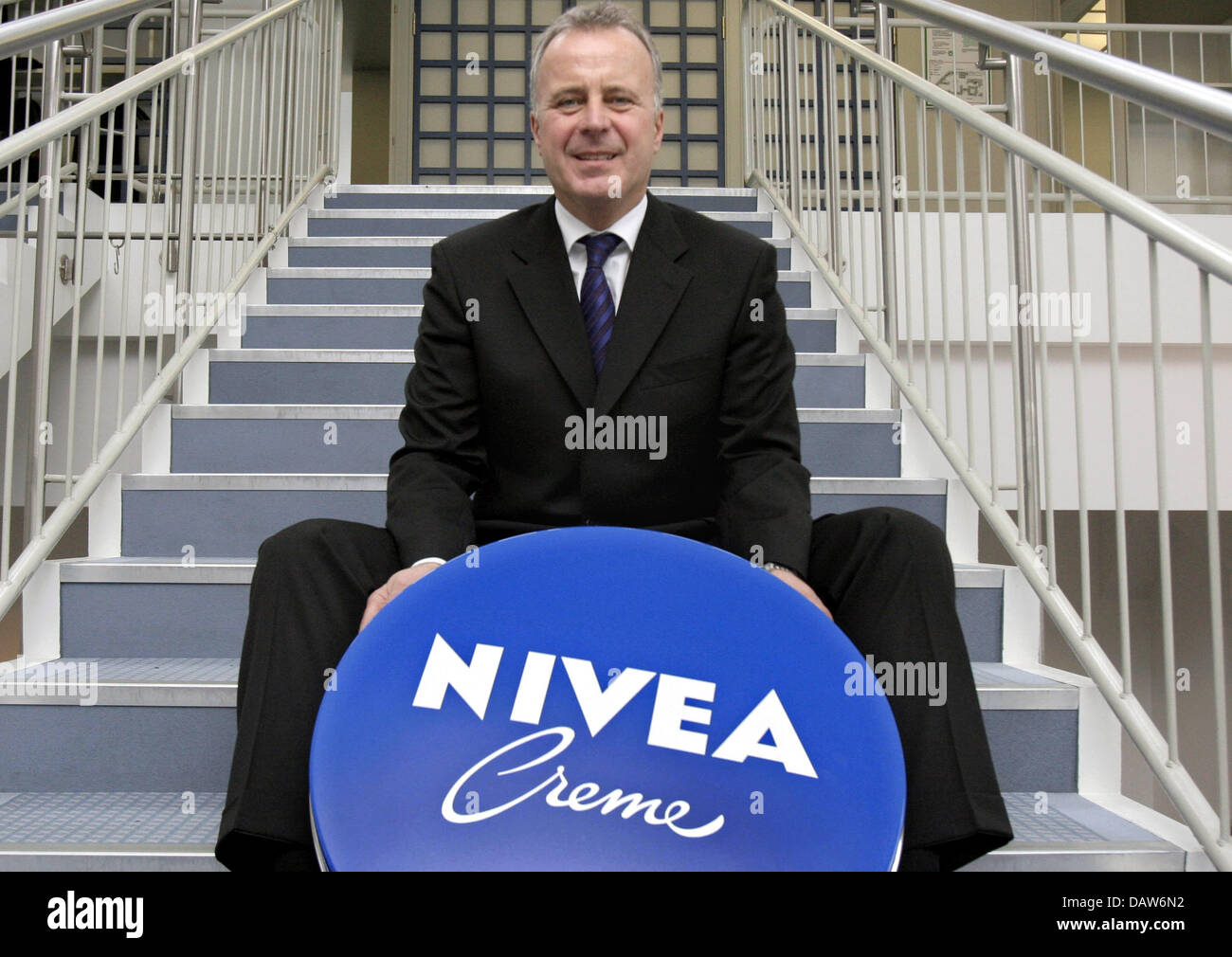 Beiersdorf AG CEO Thomas-B. Quaas poses with an oversized Nivea creme tin prior to the company's annual balance - Stock Image