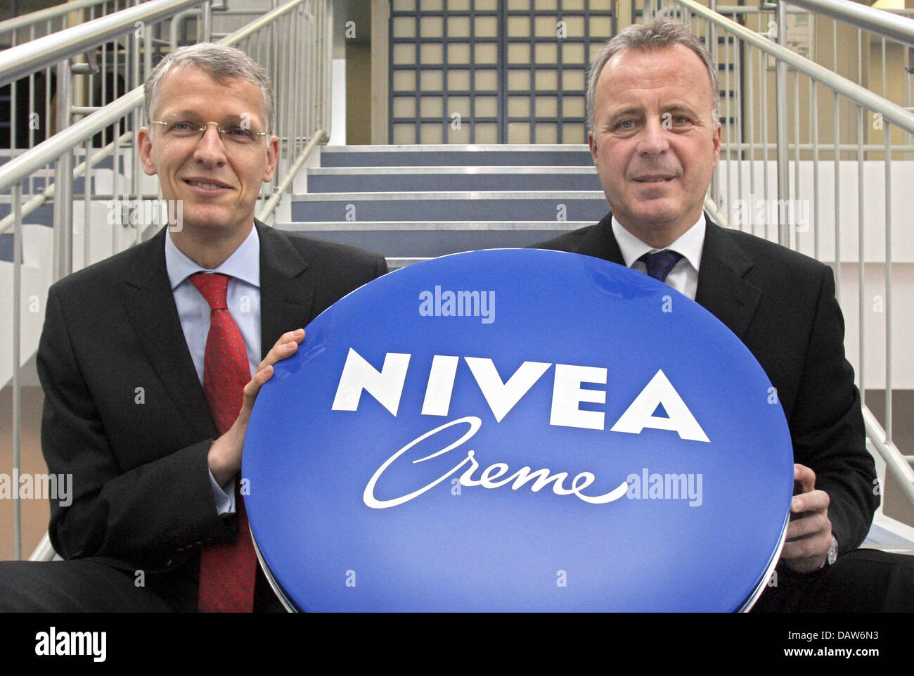 Beiersdorf AG CEO Thomas-B. Quaas (R) and management board member Bernhard Duettmann pose with an oversized Nivea - Stock Image